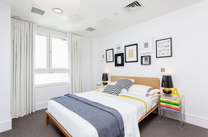 Predominantly-white-bedroom-with-smart-pops-of-color